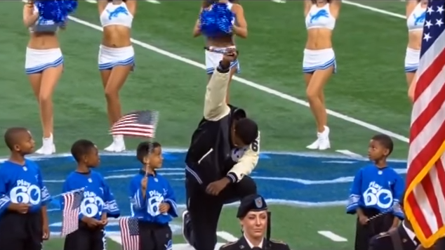Detroit-based artist Rico Lavelle took a knee after singing the National Anthem at the Lions' game Sunday.