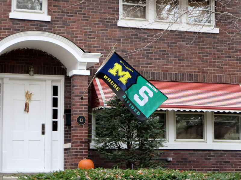A flag with both the University of Michigan and Michigan State