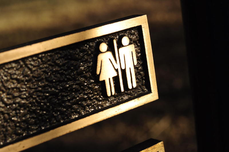bathroom sign with man and woman symbol