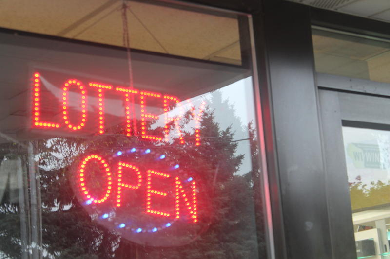 "Neon sign that reads ""lottery open"""