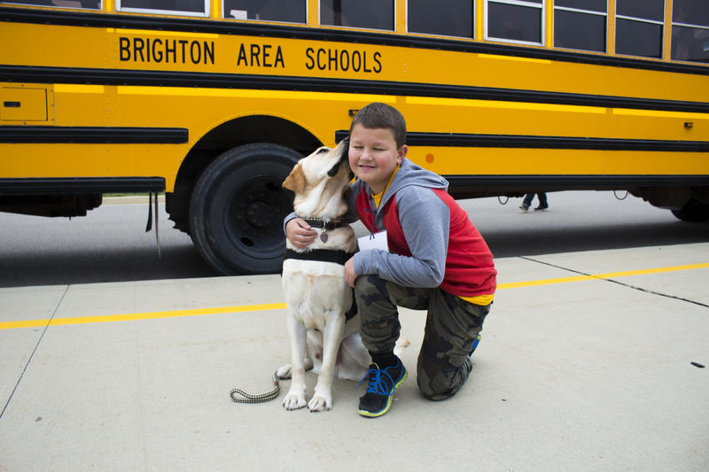 Duncan gives Maltby student Matthew Daniels a kiss before he gets on the bus for camp.