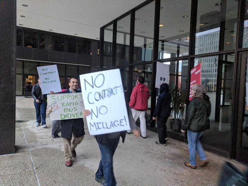 Protestors picketing outside of Grand Rapids City Hall before a city commission meeting