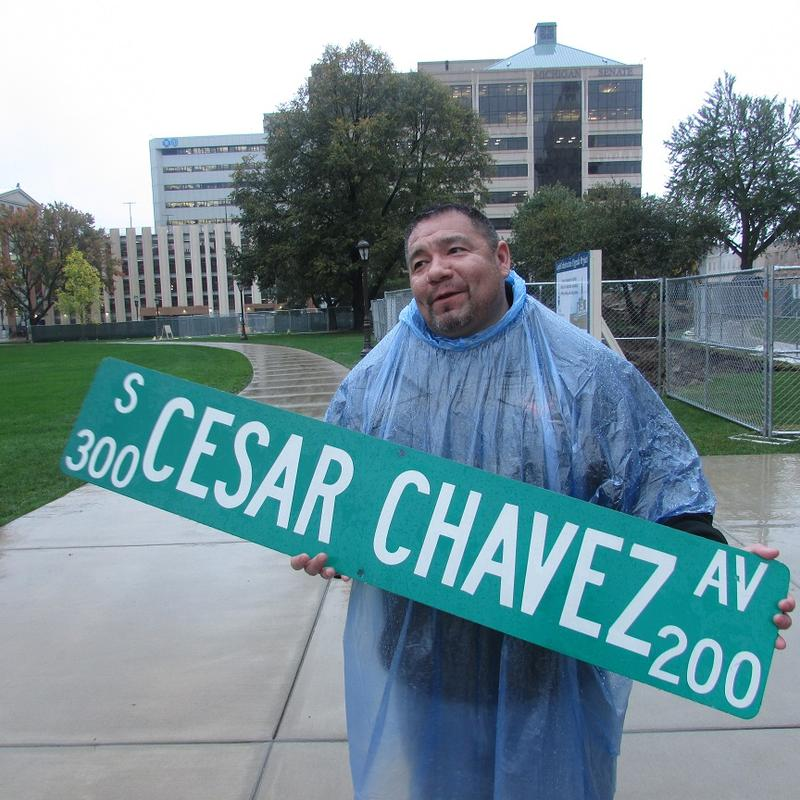Supporters of renaming part of Grand River ave to Cesar Chavez ave gathered in the rain across the street from Lansing city hall Monday afternoon