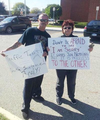 Protesters, including David Stojcevski's mother Dafinka Stojcevski, outside the Macomb County jail in October 2015.