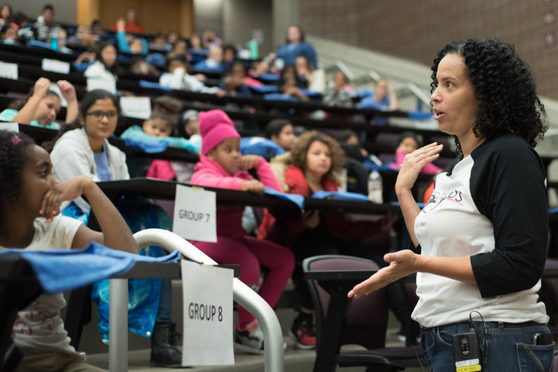 Students listen to a keynote speaker.