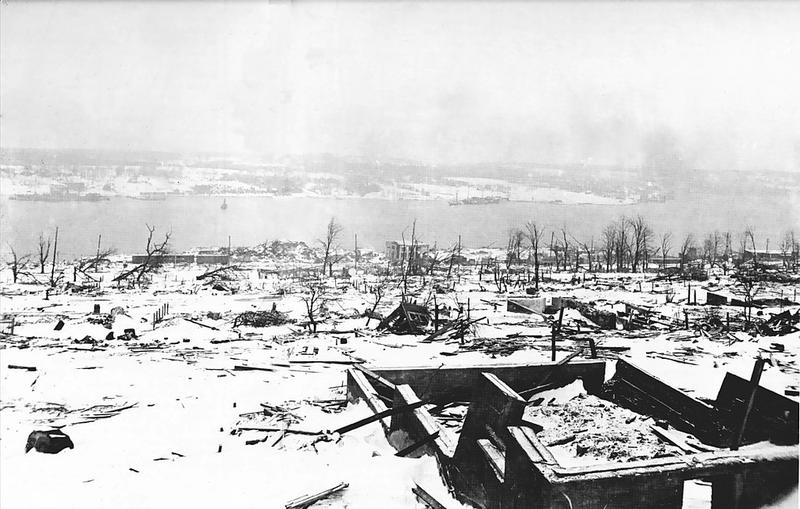 A view across the devastated neighborhood of Richmond in Halifax, Nova Scotia after the Halifax Explosion in 1917. The steamship Imo, one of the ships in the collision that triggered the explosion, can be seen aground on the far side of the harbor.