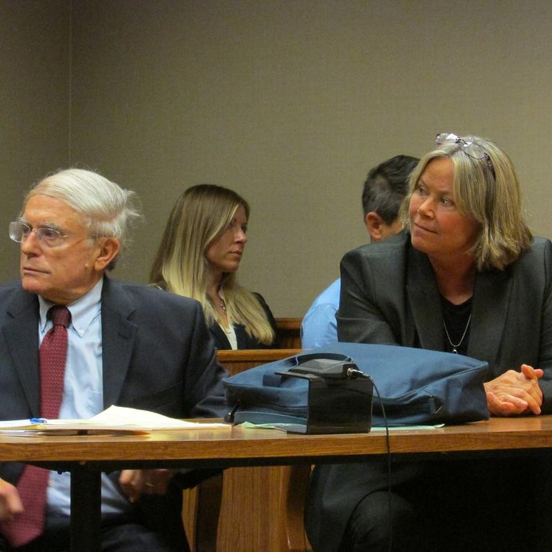 Dr. Eden Wells (right) sits with her attorney Jerald Lax during a court hearing October 9th