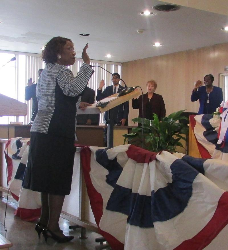 Flint City Clerk Inez Brown administers the oath of office to the new Flint city council members.