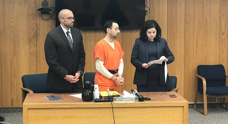 Nassar alongside his attorneys at the plea hearing in Eaton County Court Wednesday