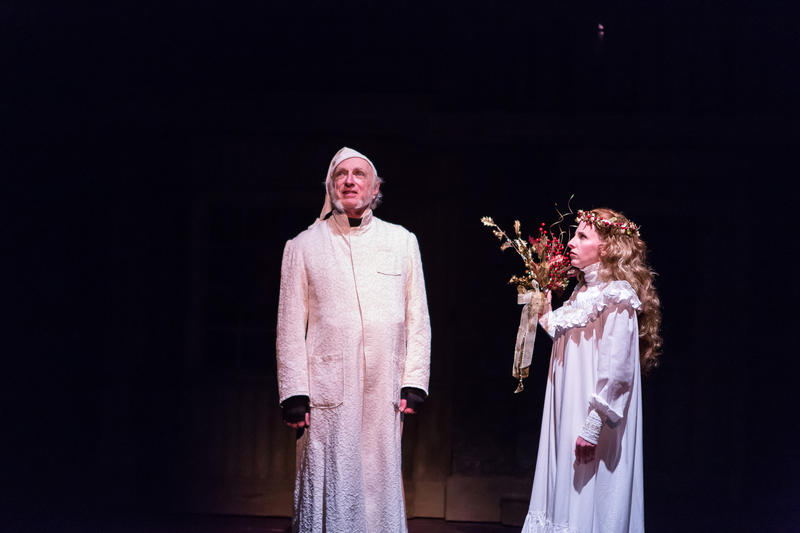 Thomas D. Mahard as Ebenezer Scrooge and Sara Catheryn Wolf as The Spirit of Christmas Past.