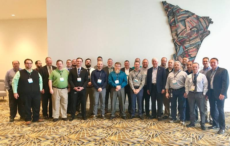 Members of the Michigan Cyber Civilian Corps at the annual North American International Cyber Summit in Detroit.