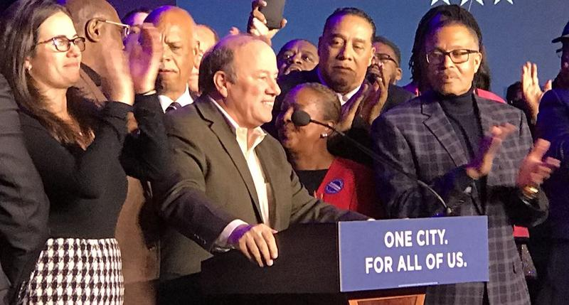 Mike Duggan celebrates winning a second term as Detroit mayor.
