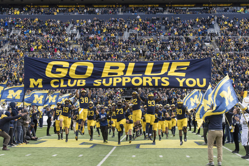 Show time. Michigan players touch the banner as they take the field a few minutes before kickoff against Rutgers on Oct. 28.
