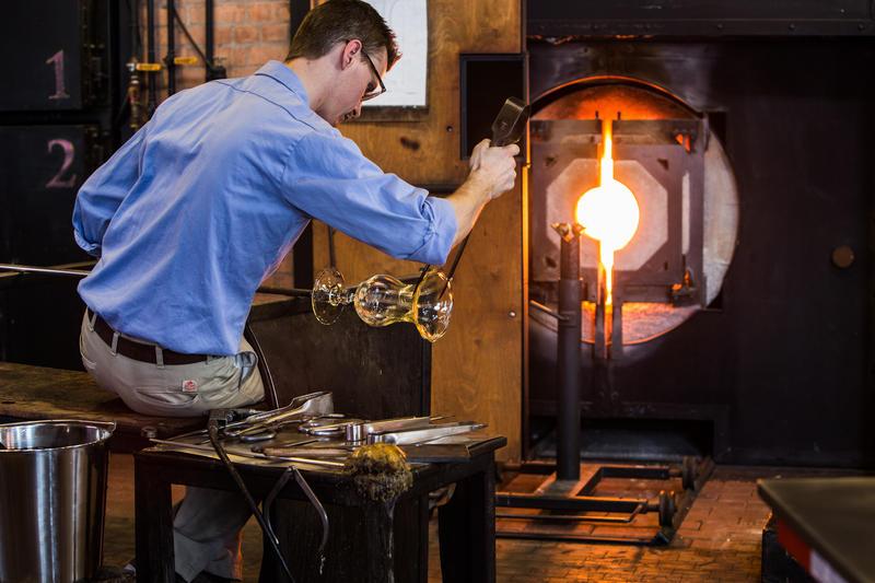 man making glass sclptures