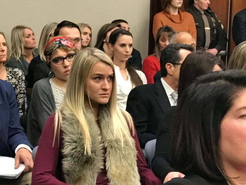 Some victims look on during the plea hearing in which Dr. Larry Nassar pled guilty to 1st degree criminal sexual conduct.