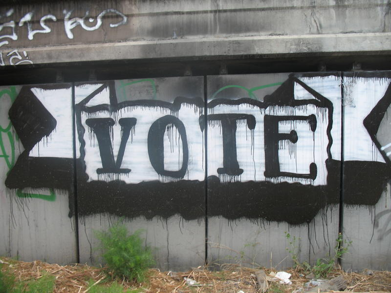 "graffiti saying ""vote"""