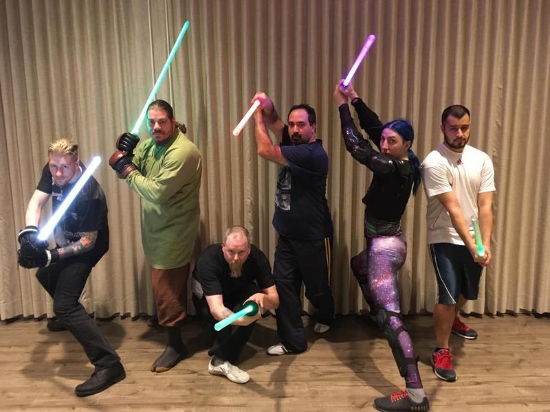 (From left) Dalton Smith, John Solomon, Chad Eisner, Rob Cocsis, Alex Kostrzewa, and Frank Diaz pose with their custom lightsabers.