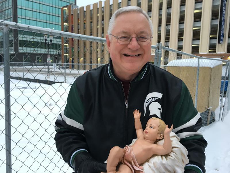 Jones holding baby Jesus