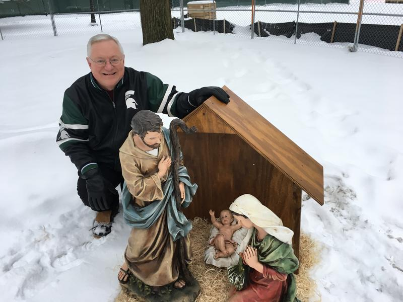Jones squats near nativity display