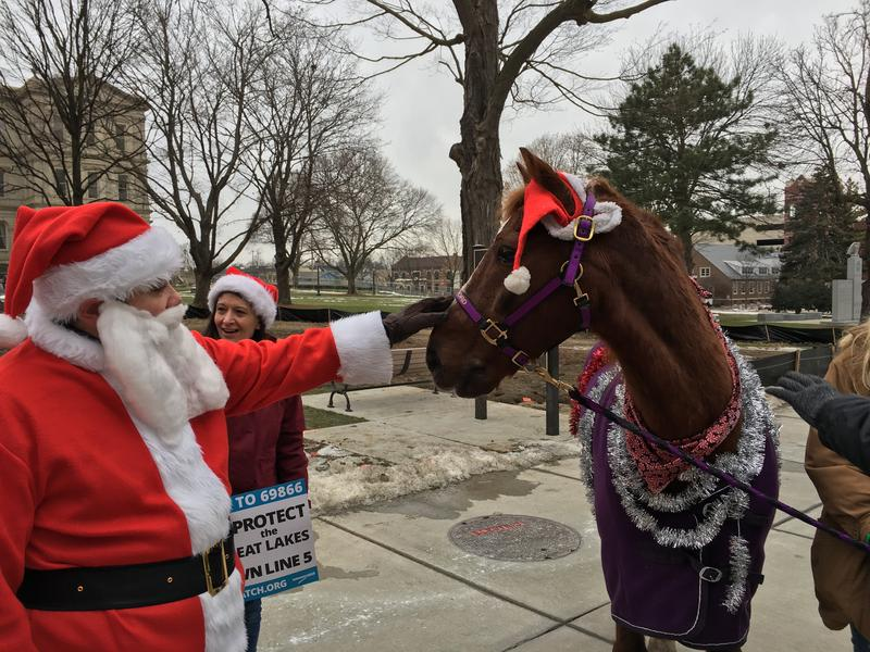 Santa and Clifford the horse made an appearance at a rally to shut down Enbridge Energy's Line 5.