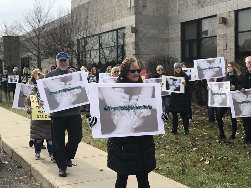 To support the victims, around 75 family members of the victims and supporters rallied outside of the courthouse and packed it nearly full for Monday's evaulation hearing.