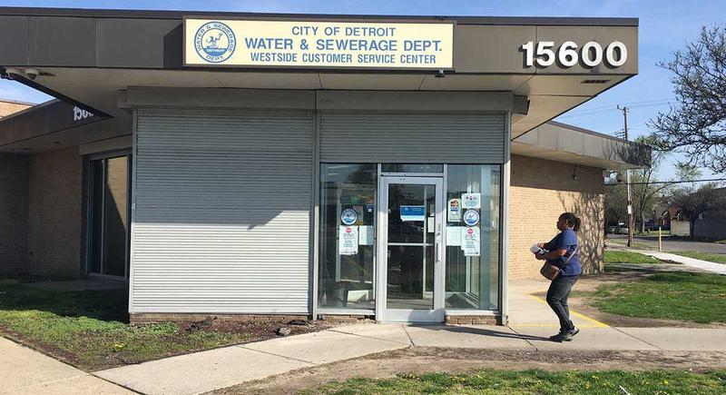 A customer walks into a Detroit Water Department customer service center