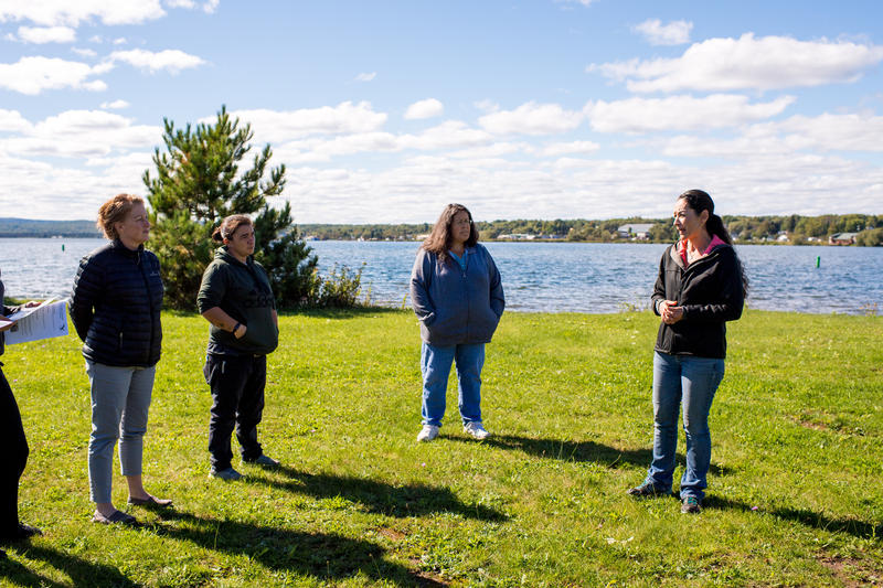 Valoree Gagnon, a researcher at Michigan Tech (far right) and Evelyn Ravindran, manager at the Keweenaw Bay Indian Community tribal fish hatchery and nursery (second from right) leading a tour on the L'Anse Indian Reservation.
