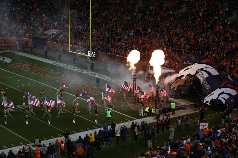 Fog blasts out of the Bronco's nostrils as Denver's pregame player introduction gets underway.