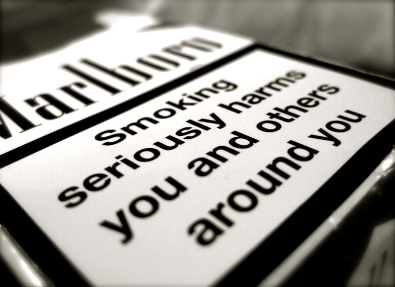 Cigarette packaging with surgeon general warning