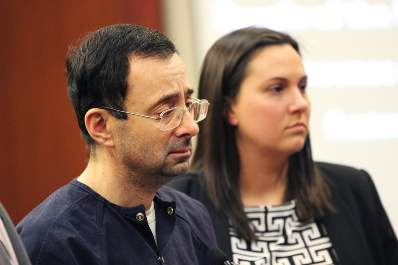 Larry Nassar listens to Ingham County Judge Rosemarie Aquilina hand down his sentence of 175 years in prison.
