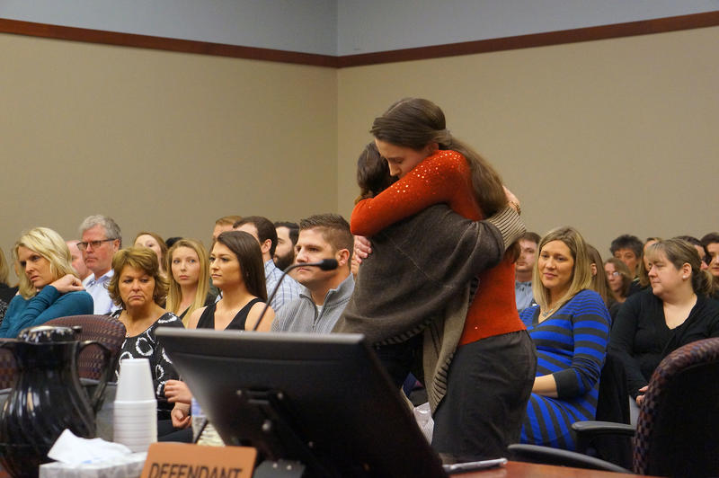 Bailey Lorencen hugs Rachel Denhollander