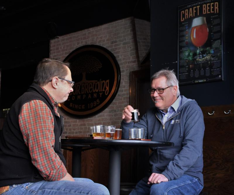 Rapai (left) and Graham (right) drink and discuss Michigan beer.