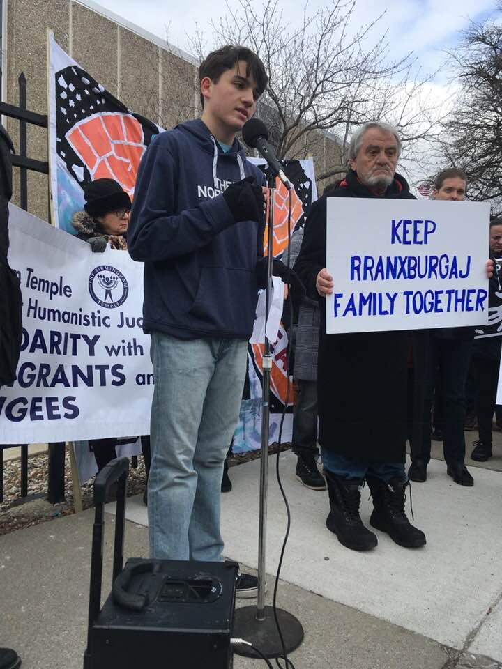 Ded and Flora Rranxburgaj's younger son, Eric, speaks on his father's behalf outside ICE offices in Detroit Wednesday.