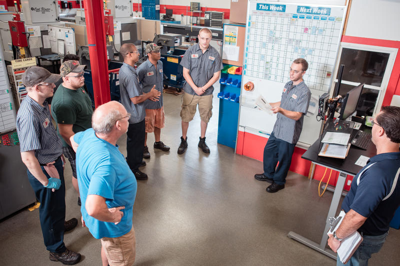 An employee-led huddle at Micron Manufacturing to make sure the first shift successfully hands off machines to the second shift.