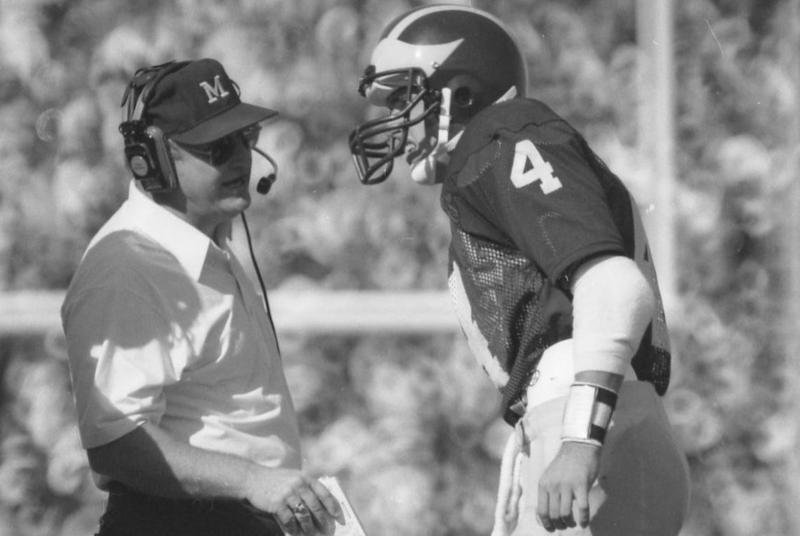 Bo Schembechler talks to Jim Harbaugh during a 1985 game against Notre Dame.