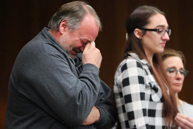 The father of survivor Katie Black weeps as his daughter speaks.