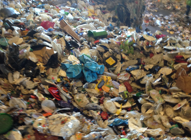 A pile of items residents in Ann Arbor put in their commingled recycle bins back in 2013.