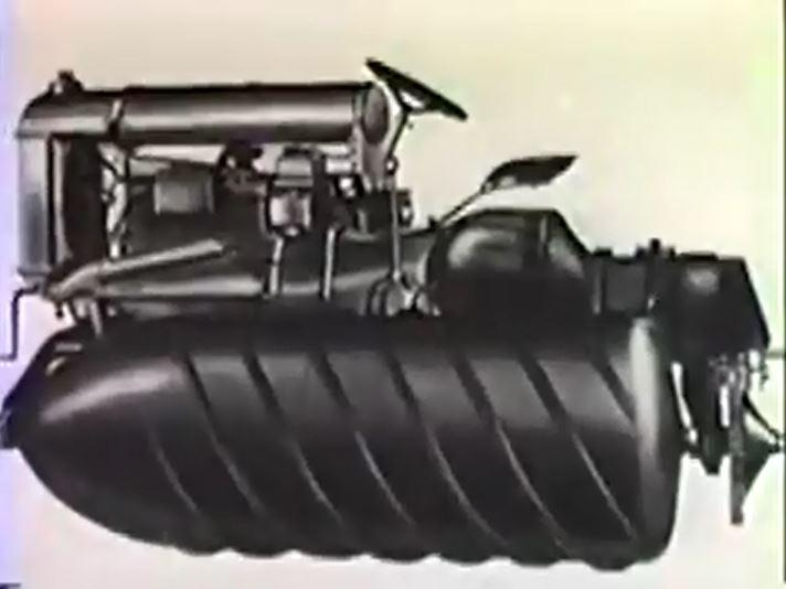 An image of the Armstead Snow Motor from the side. It resembles a tractor with two pontoons with screw tracks instead of treads.