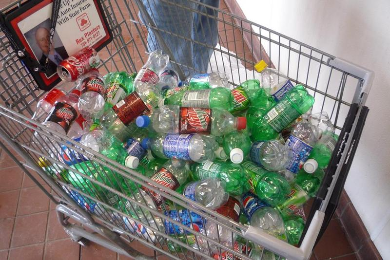 grocery cart of plastic bottles