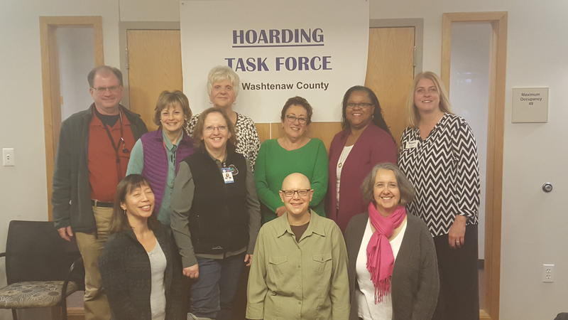 Hoarding task force: L to R: Front row: Tish Lee, Rita Fulton, Laurie Lutomski, Mary Rumman. Back row: Kevin Bell, Dina Shtull, Diane Fenske, Harriet Bakalar, Patrice LaGrand, Sheila Doeden (with Senior Helpers)