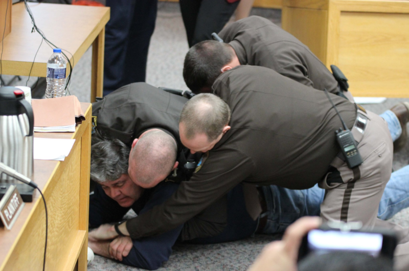 Randall Margraves, father of three victims, tackled to the ground for rushing the defense desk during Larry Nassar's sentencing hearing.