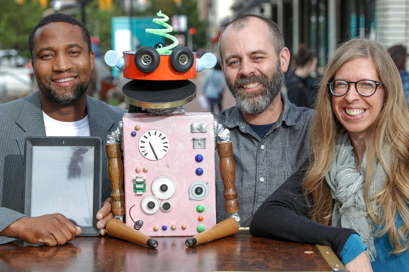 Michael Hyacinthe, Kevin Kammeraad, and Stephanie Kammeraad are the team behind the app Wimage and its mascot, Wimee