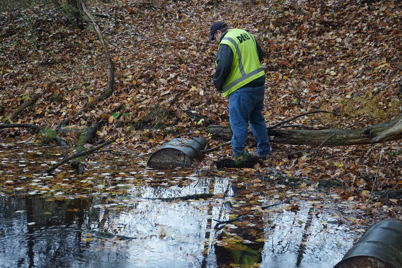 A DEQ geologist checks for potential PFAS contamination in a body of water in Michigan.
