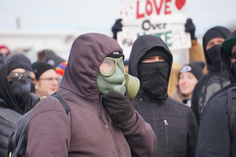 protester wearing gas mask