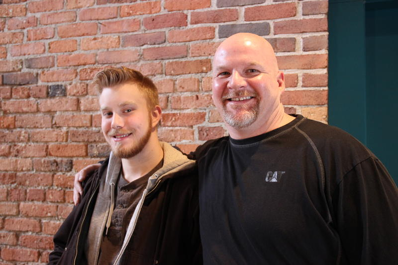 Andrew Kreszewski (left) and Rob Richmond (right) in front of a brick wall