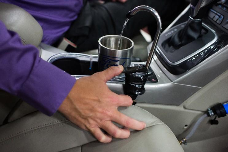 Ford's prototype of On-the-Go H2O. It collects, filters, and pumps water into a faucet over the cupholders.