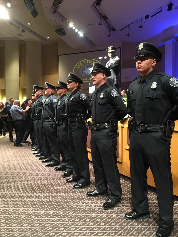 New DPD police officers receiving their badges.