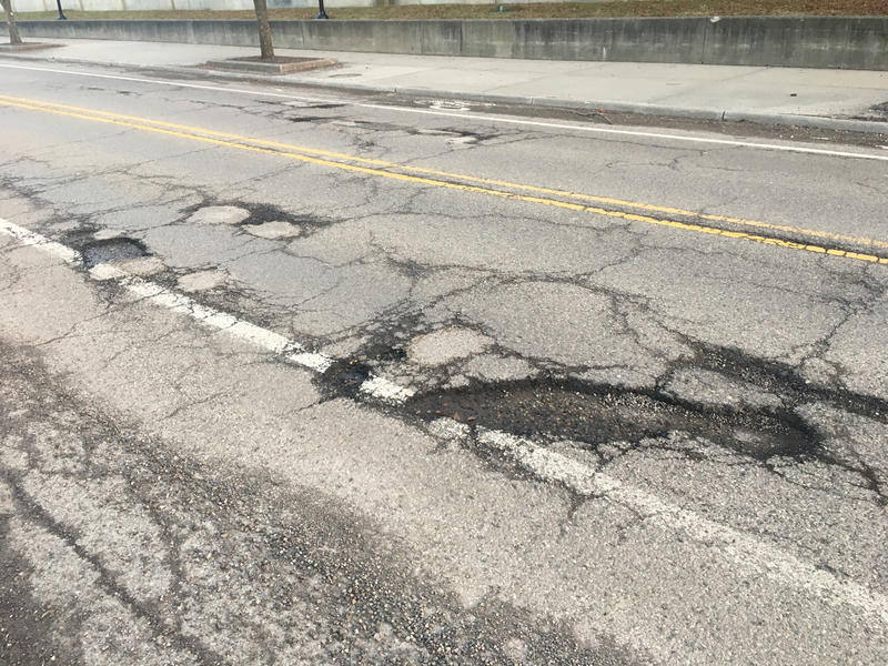 Potholes on a road in Ann Arbor.
