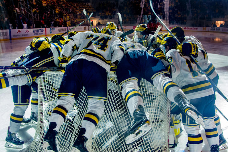 The Michigan's men's hockey team has a pregame huddle.