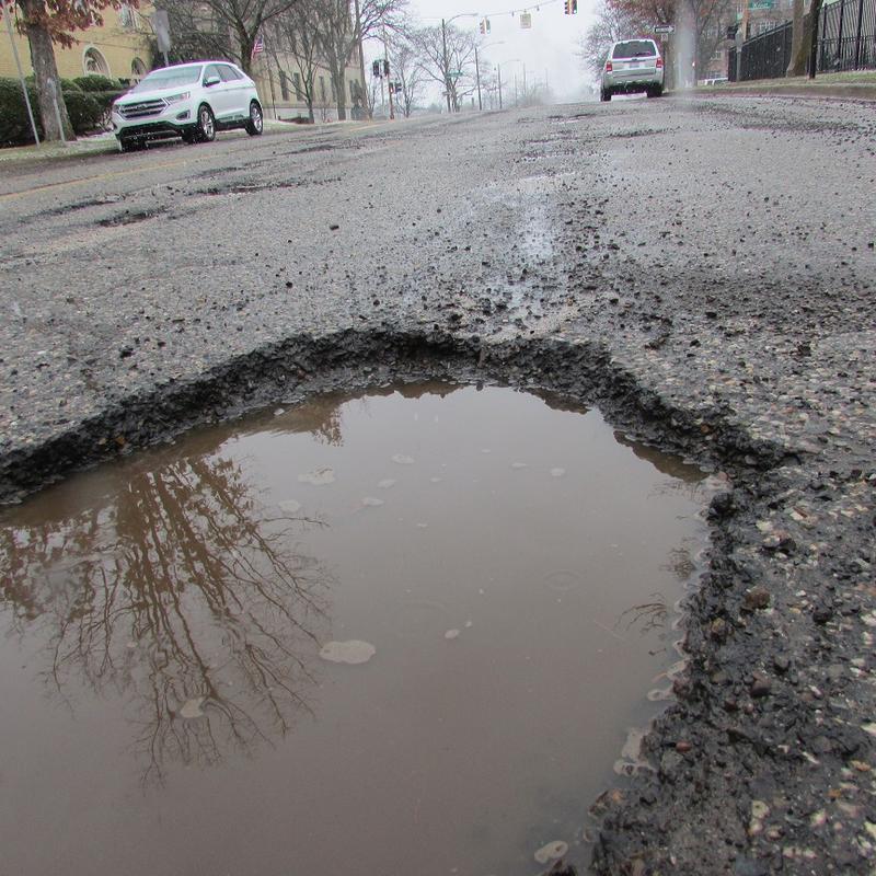 A pothole in downtown Flint.